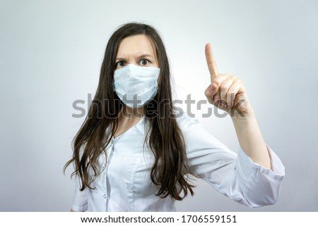 Covid19, coronavirus, woman doctor point finger with idea, wear medical mask to prevent catching virus, white coat. #1706559151