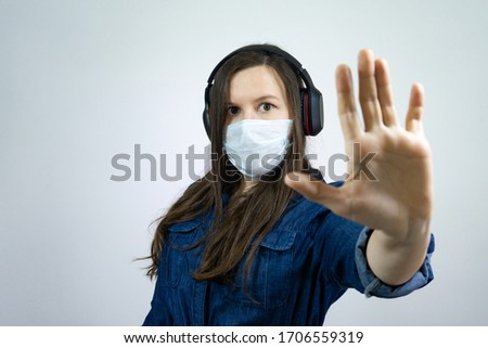 Help stop corona virus pandemic infectious disease outbreak. girl in mask with palm distance avoid communication #1706559319