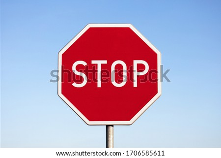 'Stop' road sign with a blue sky background