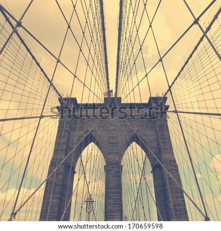 Vintage stylized closeup photo of Brooklyn Bridge, New York City