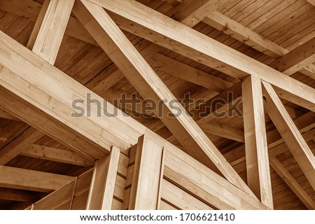 The construction of the wooden roof. Detailed photo of a wooden roof overlap construction. #1706621410