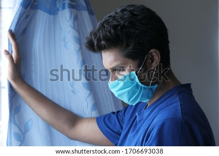 a sad man with a mask on his face coughing  #1706693038
