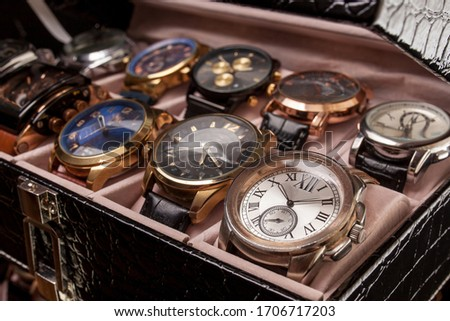 storage black leather box with collection of men wrist watches Royalty-Free Stock Photo #1706717203