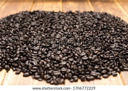 Roasted dark coffee beans background  #1706772229