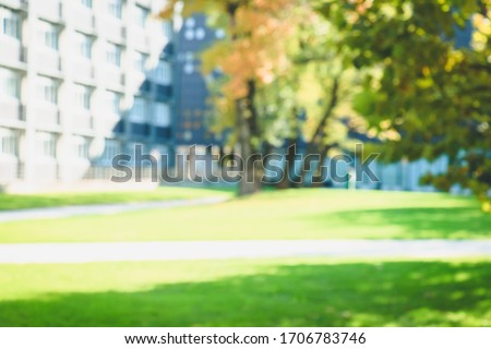 Fall blurred background with build. Buildings, windows, trees, study. A part of white buildings with windows, trees and gazon. Place for your text. #1706783746