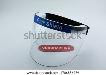Face shield on a white background. Pandemic COVID-19 virus and protection against coronavirus concept. Royalty-Free Stock Photo #1706856979