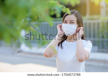 Asian young woman wearing a hygiene protective mask over her face. #1706873788