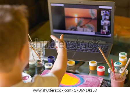Creative toddler boy is creativity and the artist in an online drawing paints lesson. Childrens creativity. The concept of distance learning online school for the period of global quarantine. #1706914159