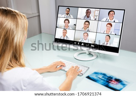 Doctor In Online Medical Video Conference With Diverse Team Of Hospital Workers #1706921374