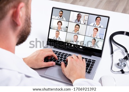 Doctor In Online Medical Video Conference With Diverse Team Of Hospital Workers #1706921392