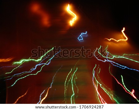 Colorful lights of lightning travel at slow shutter speed