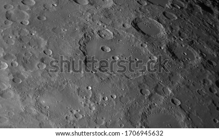 Close up to the Clavius crater on Moon and other details in the backgound. Royalty-Free Stock Photo #1706945632