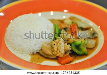spicy squid or stir fried squid, fried squid and rice