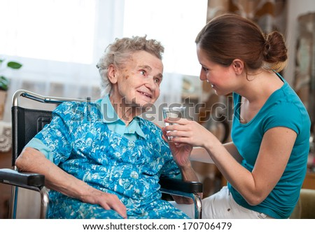 Senior woman with her caregiver at home #170706479