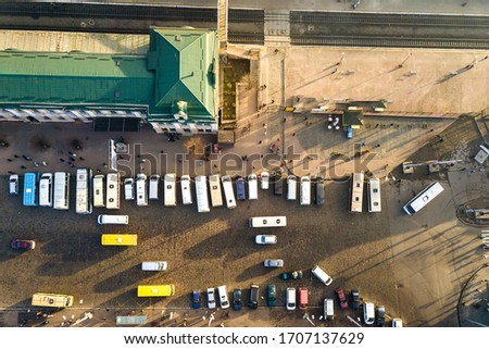 Aerial view of many cars and buses moving on a busy city street in front of railway station building in Ivano-Frankivsk city, Ukraine. #1707137629