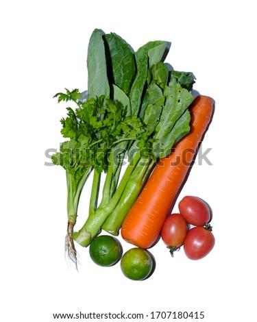 This picture shows vegetables;cartot tomato lemon coriander kale