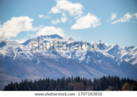 Lake Wanaka landscape picture with snow mountain background. Famous attraction in the south island of New zealand.