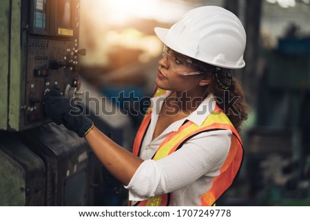 Professional engineer black women , worker, woman afican mechanical, maintenance, check in factory, warehouse Workshop for factory operators, engineering women training. Business factory industry. #1707249778