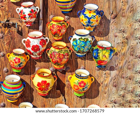 Ceramic bowls on a wall in the south of Spain