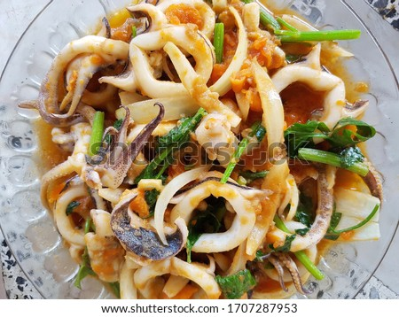 Stir-fried squid with salted eggs : Is a popular and tasty Thai food, not spicy. Use fried squid and salted egg yolk to taste mellow. Squid has high cholesterol and should not be eaten often.