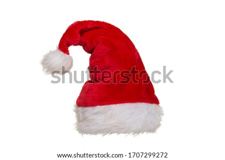 Red and white hat of santa claus isolated on a white background Royalty-Free Stock Photo #1707299272