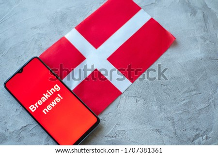 Breaking news, Denmark country's flag and the inscription news, concept for news feeds about the country Denmark #1707381361