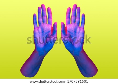 Two hand in a pop art collage style in neon bold colors. Modern psychedelic creative element with human palm for posters, banners, wallpaper. Copy space for text. Magazine style. Zine culture. Royalty-Free Stock Photo #1707391501