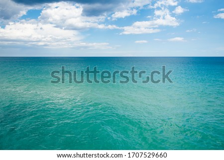 scenery view of transparent water and blue sky with horizont line #1707529660