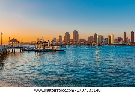 San Diego skyline is in the background with the ferry from Coronado Island docked at the wharf ready to leave for San Diego. #1707533140