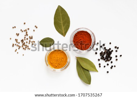set of assorty colorful spices and herbs in bowls on white background, flat lay, top view #1707535267
