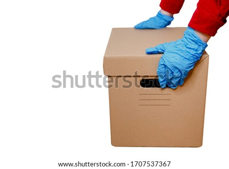 Delivery man holding cardboard boxe. Fast and free delivery transport #1707537367