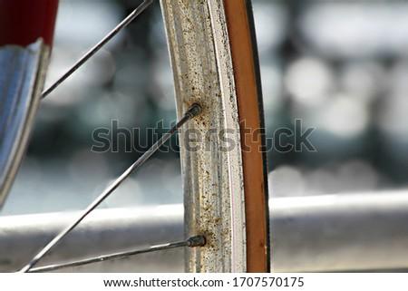 Old bicycle metal rod / wheel. Blur background image. #1707570175