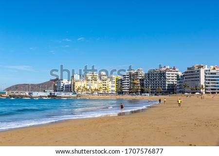 Las Canteras Beach (Playa de Las Canteras) in Las Palmas de Gran Canaria, Canary island, Spain. One of the top Urban Beaches in Europe. 3 km stretch of golden sand is the heart and soul of Las Palmas Royalty-Free Stock Photo #1707576877