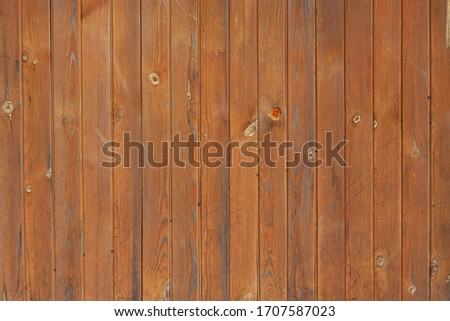the background of an old wooden wall faded from the sun #1707587023
