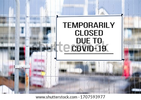 Closed building site sign due to Coronavirus Covid-19