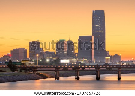 Oklahoma City, Oklahoma, USA downtown skyline on the Oklahoma River at dusk.