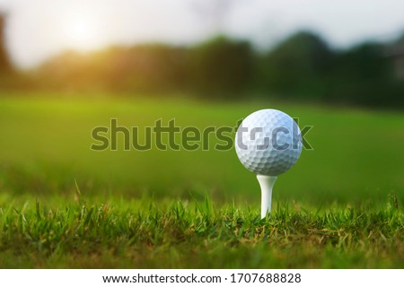 golf ball on tee in a beautiful golf course with morning sunshine.Ready for golf in the first short.Sports that people around the world play during the holidays for health. Royalty-Free Stock Photo #1707688828