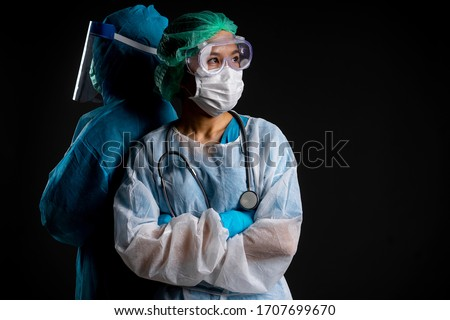 doctor in PPE suit uniform has feeling motivating in Coronavirus outbreak or Covid-19, Concept of Covid-19 quarantine.and medical care team during covid-10 period.  #1707699670