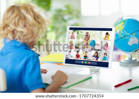 Online remote learning. School kids with computer having video conference chat with teacher and class group. Child studying from home. Homeschooling during quarantine and coronavirus outbreak. #1707724354