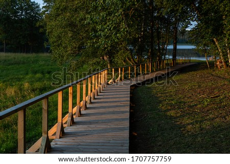 wooden footbridges by the lake Royalty-Free Stock Photo #1707757759