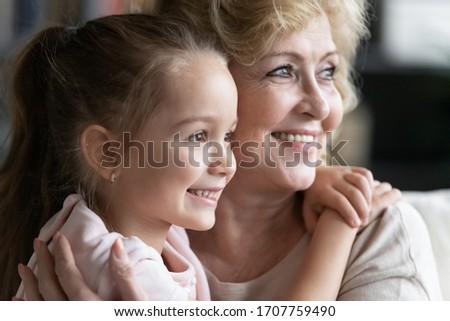 Close up image caring elderly grandmother and small granddaughter embracing looking aside happy multi-generational family relatives people portrait, understanding strong attachment best friend concept Royalty-Free Stock Photo #1707759490