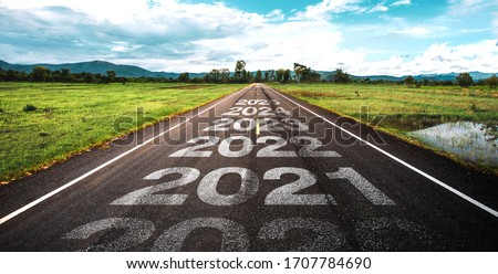 2020-2025 written on highway road in the middle of empty asphalt road  and beautiful blue sky. Concept for vision 2021-2025. Royalty-Free Stock Photo #1707784690