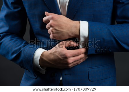 Perfect to last detail. Getting dressed. Formal suit shirt and cuffs. Wearing formal style. Fashion and style. Formal clothes. Dress code. Wedding ceremony. Holiday celebration. Formal and classy. #1707809929