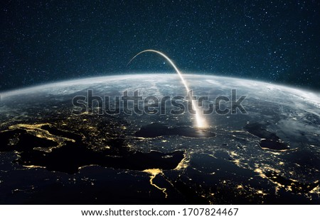 Rocket launch on a night planet earth with lights. Concept of successful satellite launch. Spaceship flies over the planet. View from space #1707824467