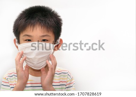 The boy wearing mask for protect from coronavirus pandemic, medical protection concept #1707828619
