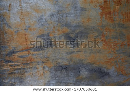 Dark textured painted cracked multicoloured rusty aged metal background. Royalty-Free Stock Photo #1707850681