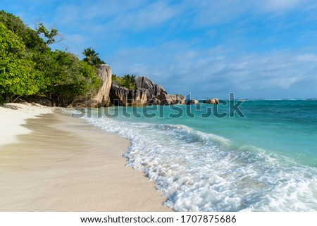 Anse Source d'Argent at La Digue Island, Seychelles. Heavenly beach with dazzling white sands, crystal clear waters, surrounded by beautiful granite boulders and coconut palms.