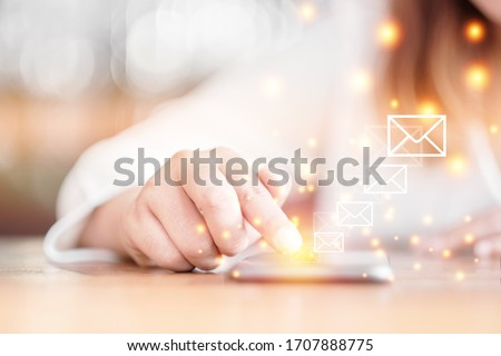 Selective focus woman hand with Messages icons on smartphone screen. Communication Email concept. #1707888775
