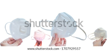 Hands holding different side of n95 face mask for protect corona virus (covid-19) and pm2.5  on white background. #1707929557
