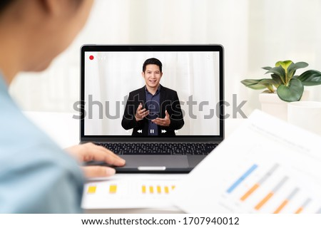 Young asian chinese leader or businessman on management forum, teleconference, town hall or press video conference online with work remotely at home during coronavirus and business continuity concept.